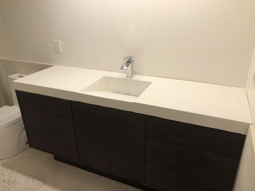 Custom Concrete Bathroom Vanity With Integrated Ramp Sink