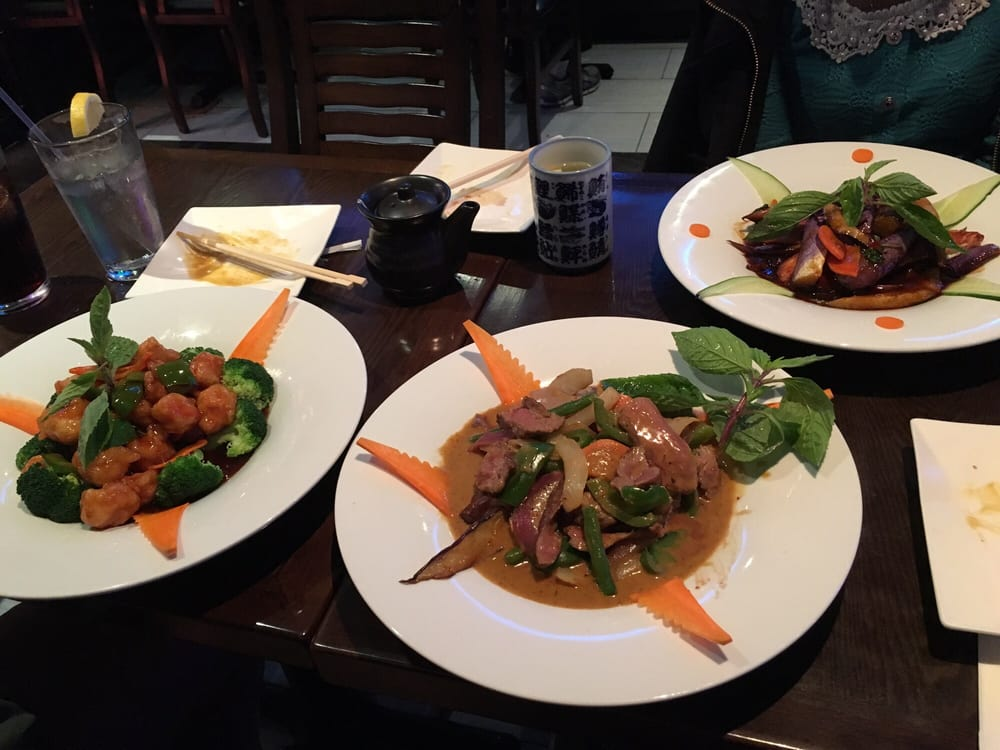 Our entrees - sesame chicken, curry beef, and eggplant - Yelp