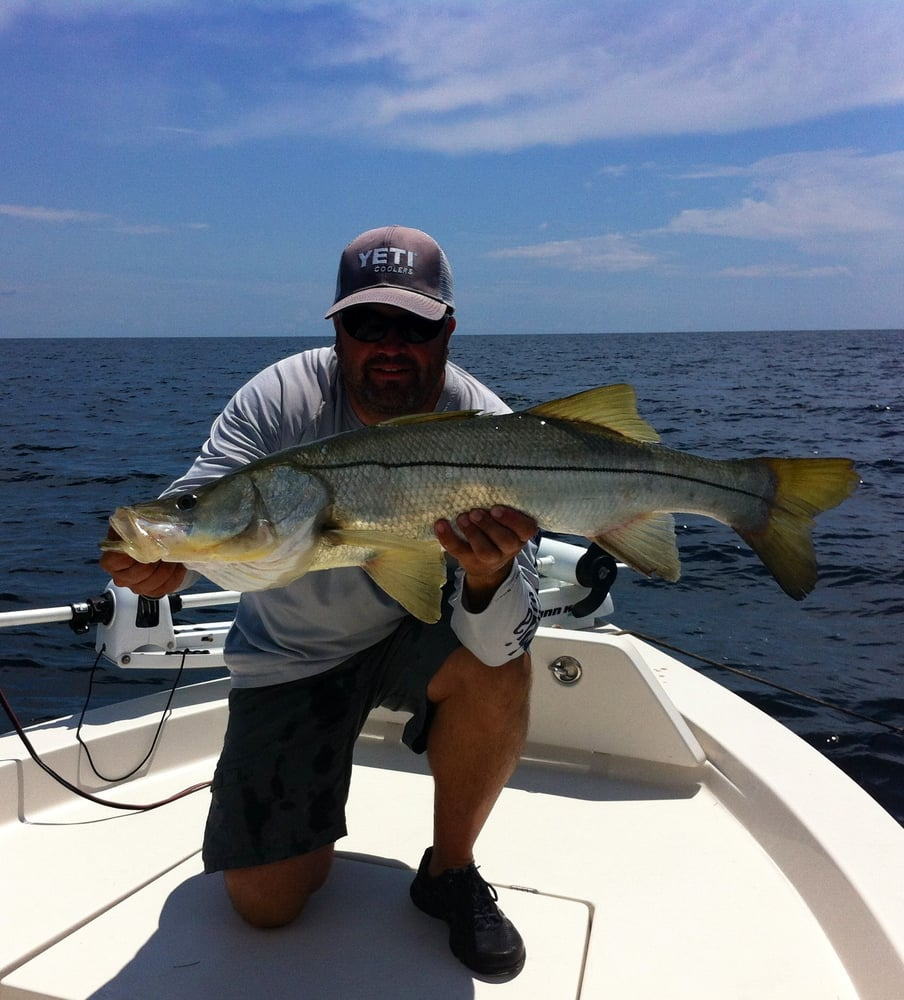 Captain matt with his prize winning snook yelp for Bonita springs fishing charters