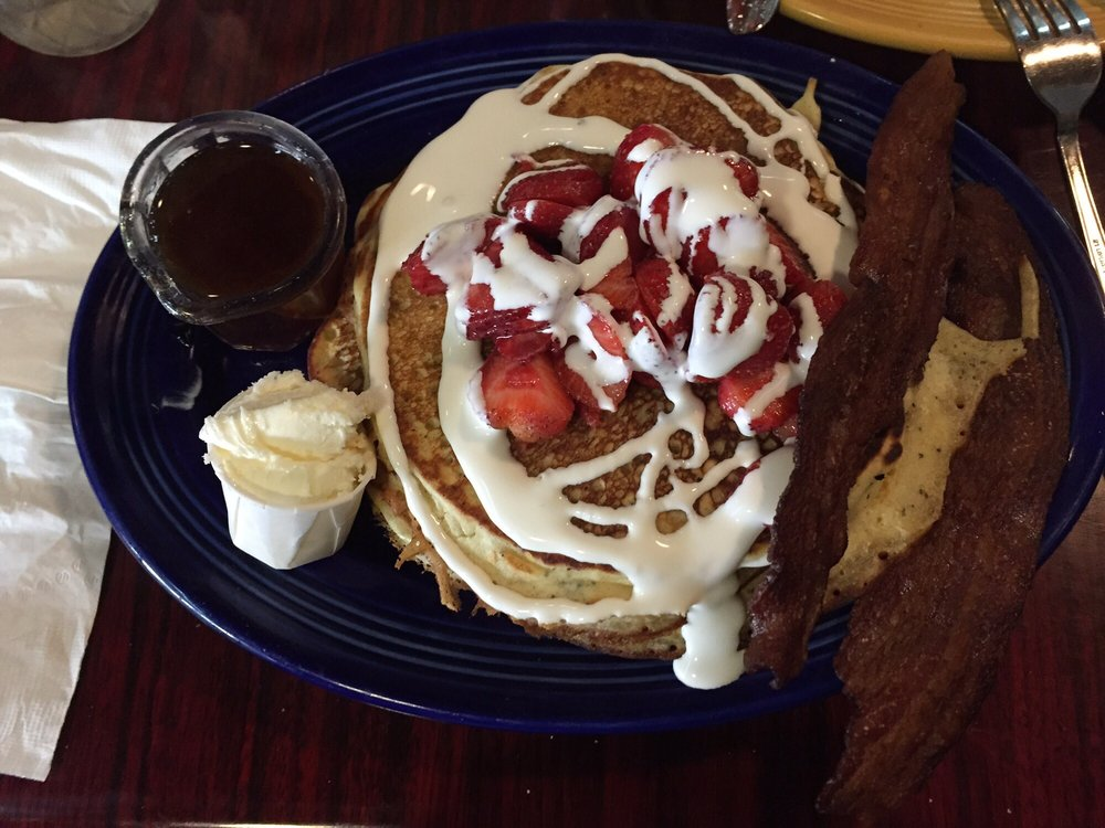 ... Pancakes. Toped with creme fraiche and farm fresh strawberries. Side