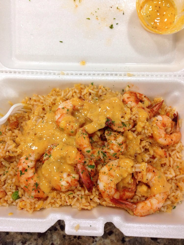 Loud pack. Louisiana fried rice, topped with boiled shrimp, all mixed together in the crack ...