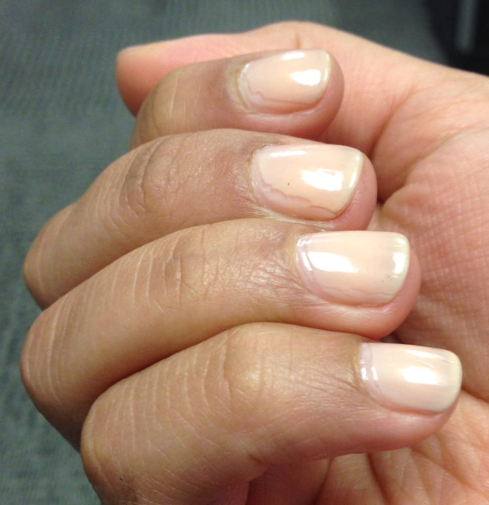 Bad edging job on natural nails with a neutral semi-transparent ...