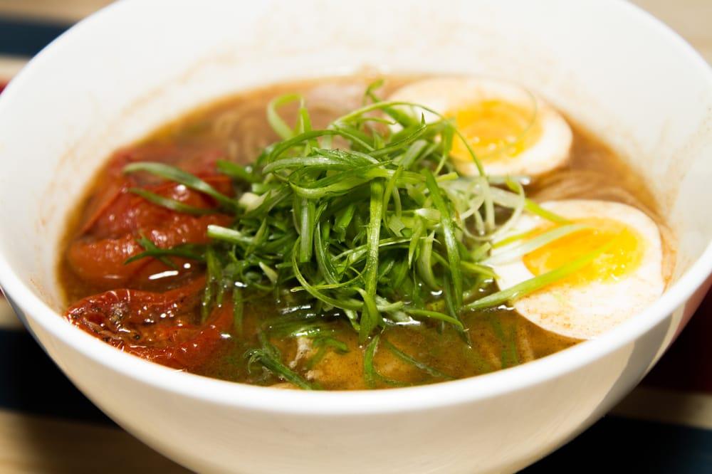 Ivan Ramen Slurp Shop classic shoyu + egg + roast tomato + chili garlic oil $18 - yelp