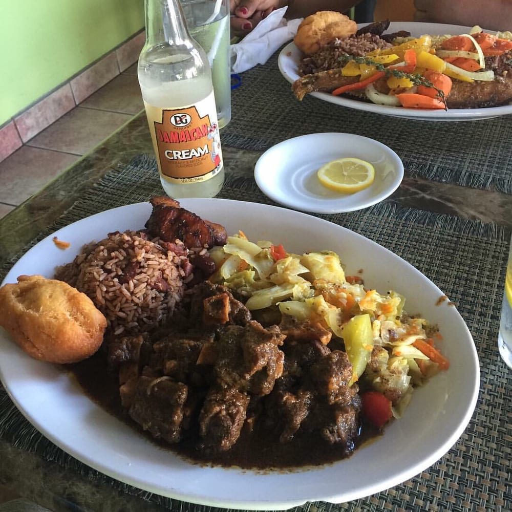 Oxtails mixed veggies rice beans festival bread with for Ackee bamboo jamaican cuisine