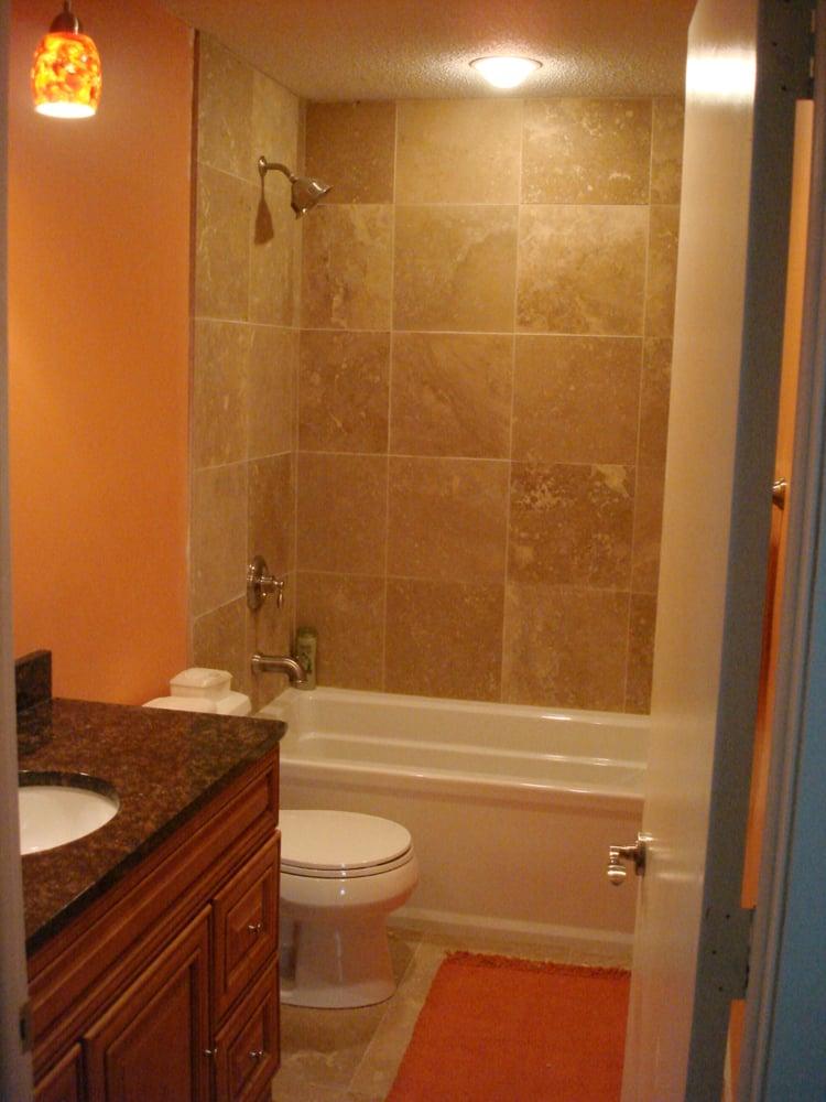 Travertine 16x16 Tiles Installed With Kohler Bathtub And