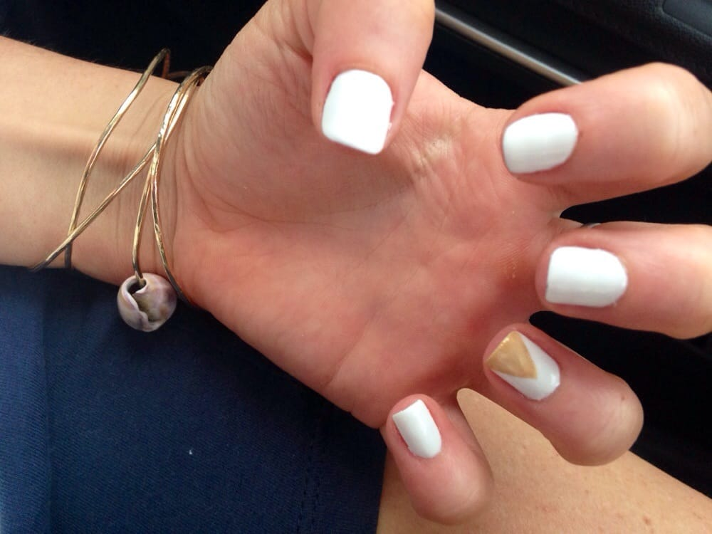 White gel nails with a gold triangle design by Tracy. - Yelp
