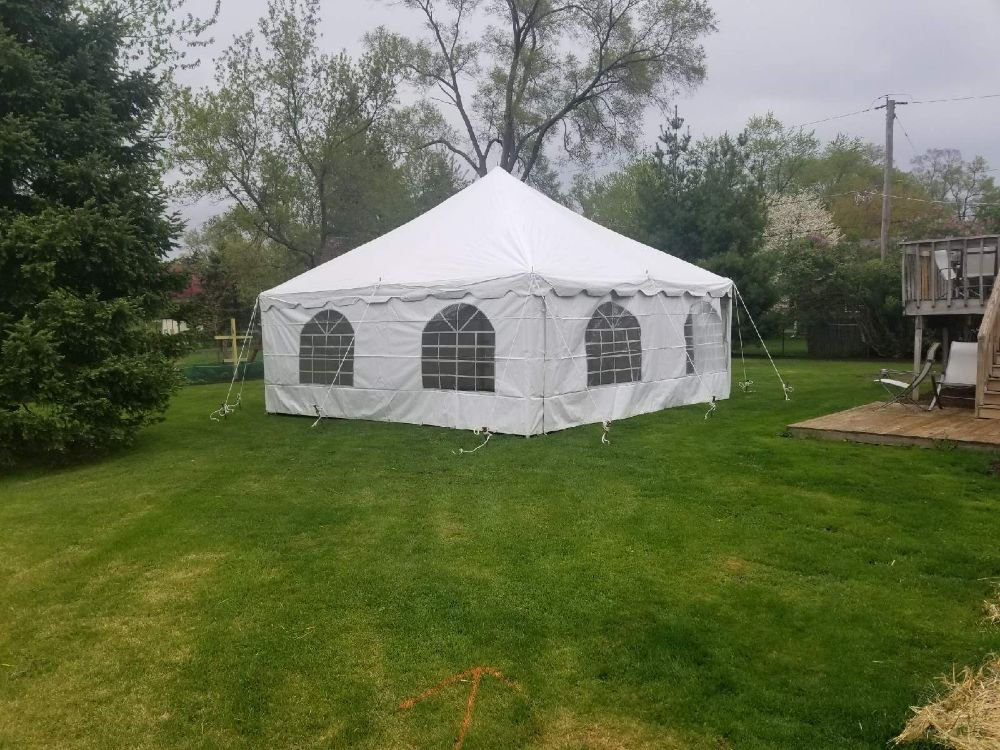 20x20 canopy pole tent set up in grass with side walls - Yelp