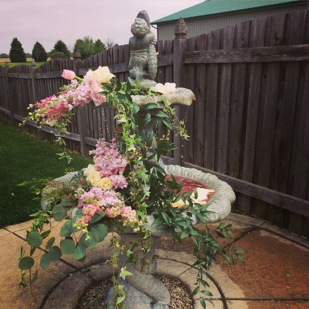 8e6d55085cf1 Beautiful blush pink and greenery flowing from the backyard fountain ...