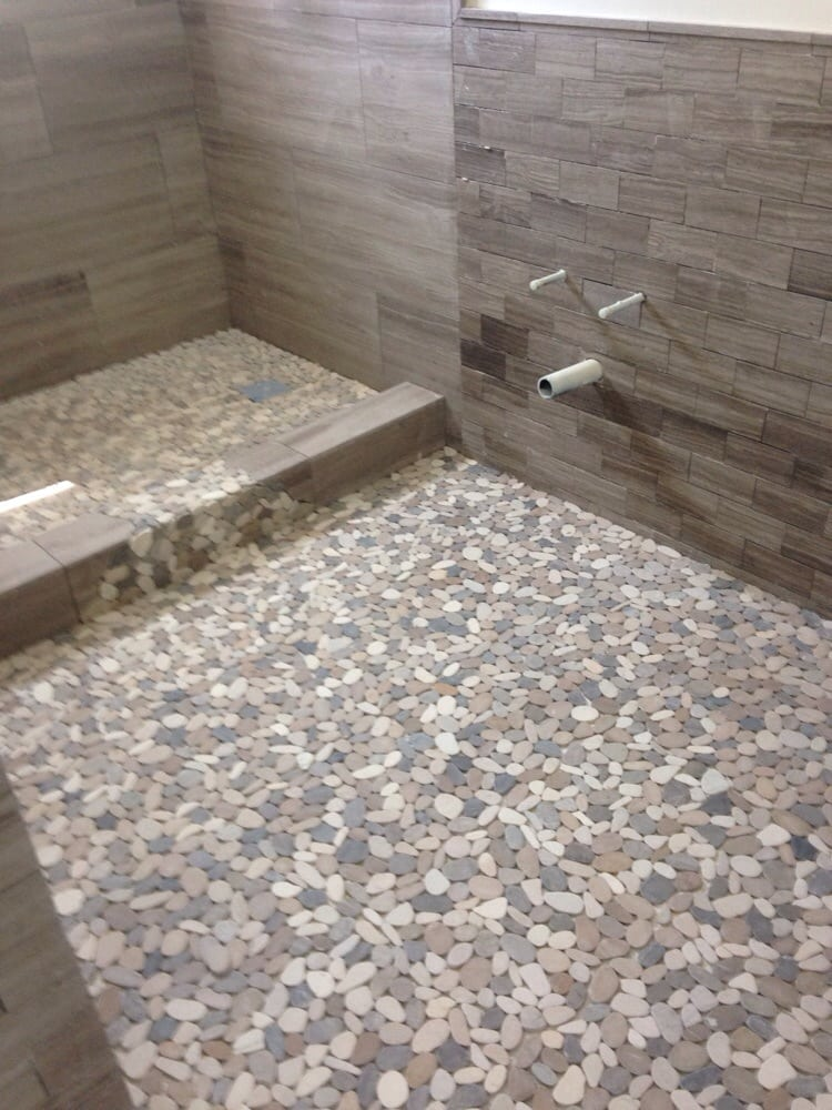 Flat Pebbles On Shower Pan Spilling Over To Bathroom Floor