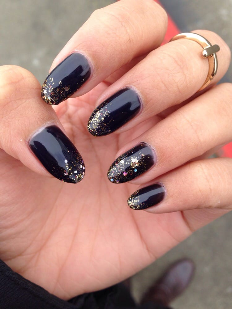 Black gel manicure with gold glitter gradient on natural nails! The ...