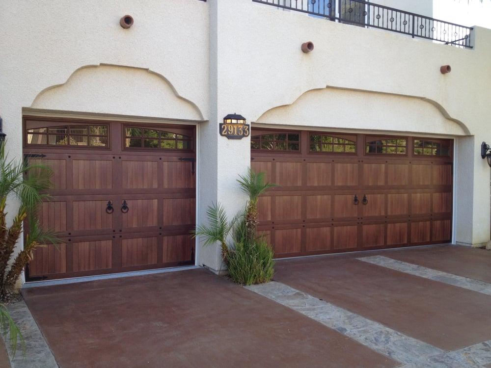 Wood like garage doors made from steel to look like real for Wood like garage doors