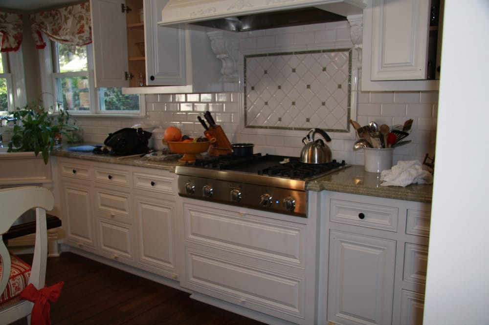 We spray kitchen cabinets yelp for Kitchen cabinets venice fl
