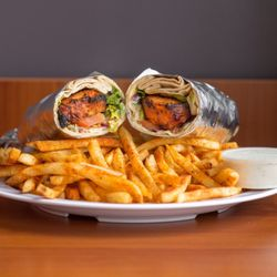 Photo of D's Dubai Sauce - Los Angeles, CA, United States. House seasoned fries with our chicken kabob wrap is the perfect combo...don't forget to sauce it up!