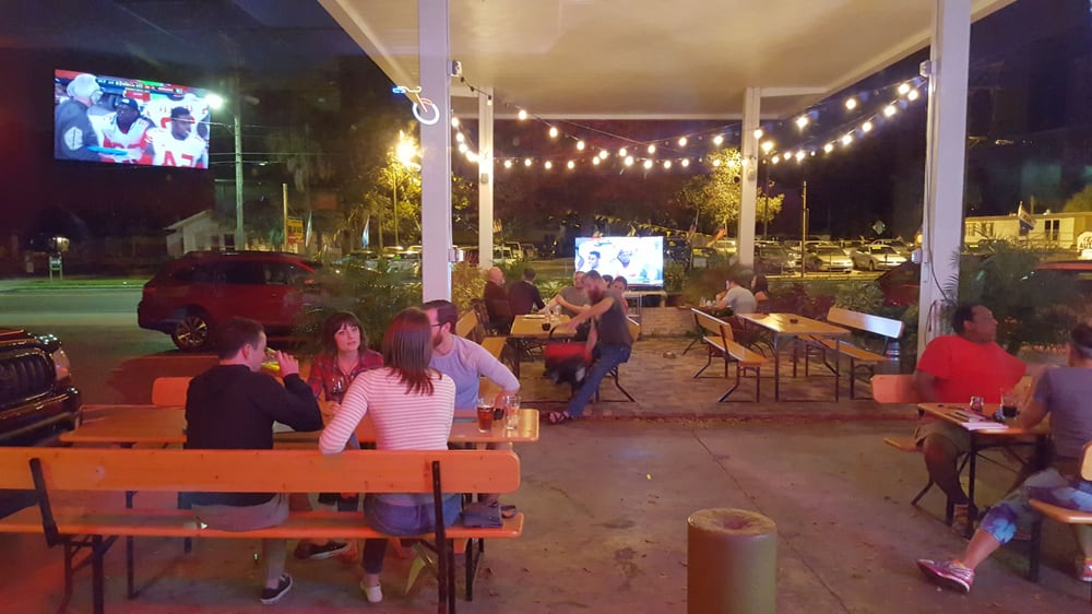 Covered Outdoor Patio With The Big Screen Tv Right Along