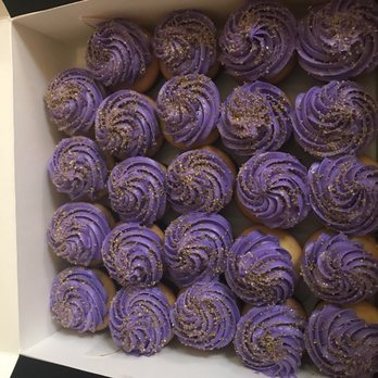 Vanilla cupcakes with purple buttercream icing and gold
