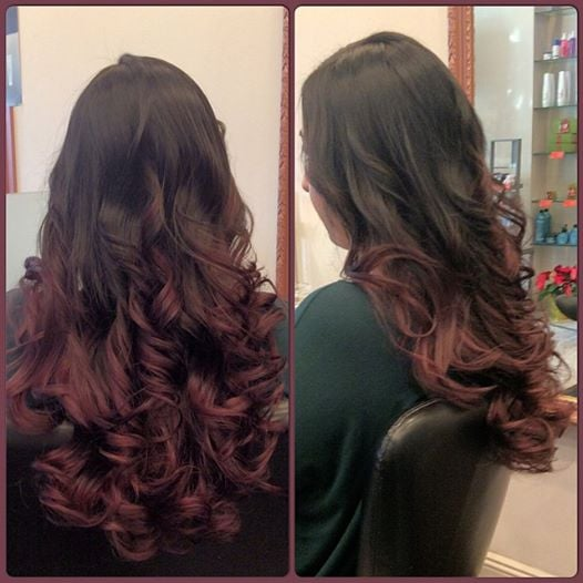 A red purple balayage on a dark brown base and wavy for A la mode salon brooklyn