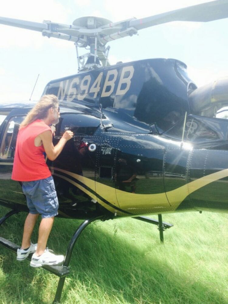Touching up the paint on a customer 39 s helicopter yelp for Paint chip repair near me