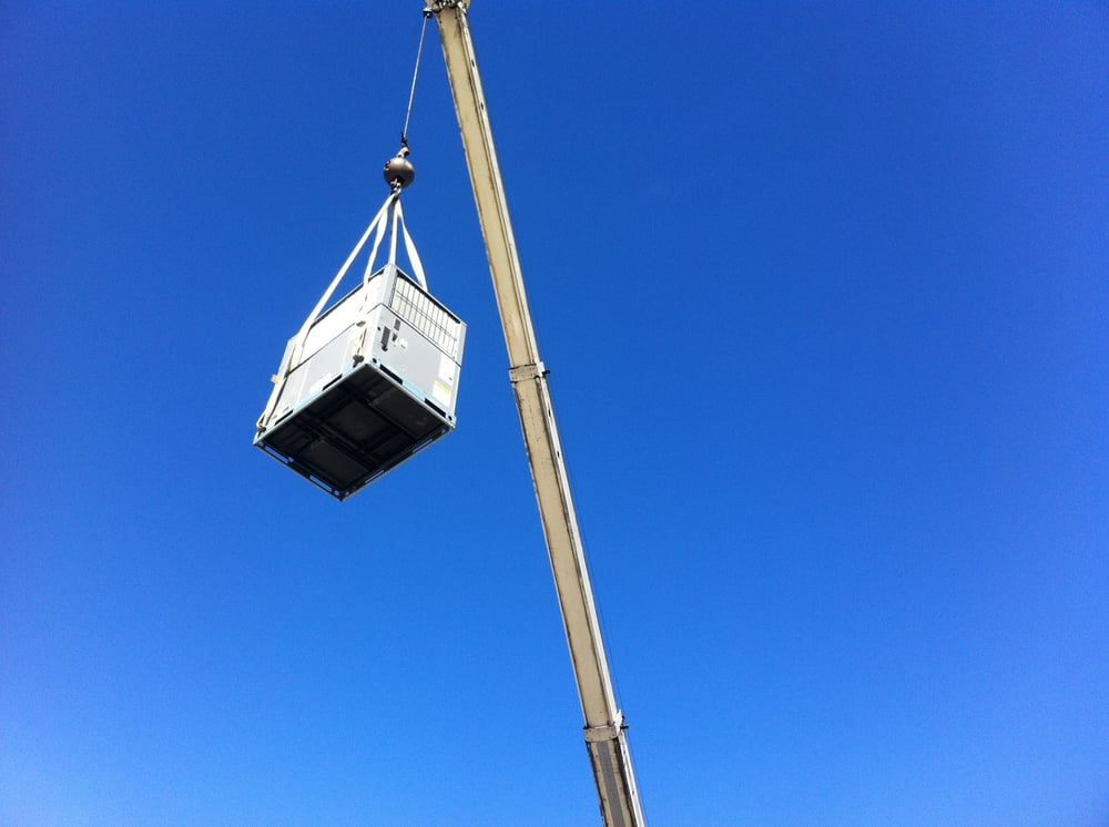Photo of Air Maintenance Heating & Cooling - Tucson, AZ, United States. Crane lift on a 2.5 ton package unit