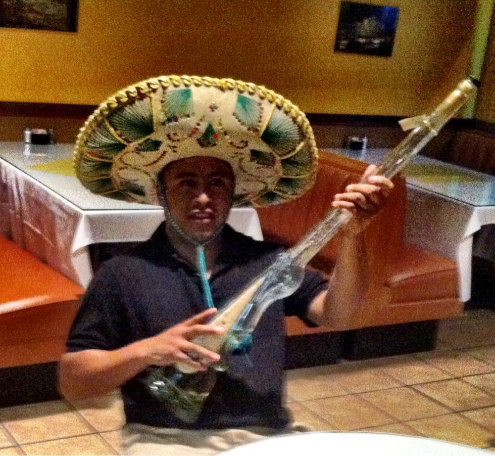 Jorge With His Tequila Shot Gun At Nachos Last Night.