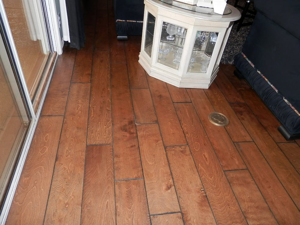 Warped hardwood flooring following a water loss yelp for Hardwood floors warping