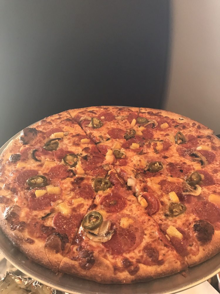 Photo of Hot Mama's Pizza & Brew - Duck Creek Village, UT, United States. Pepperoni, mushrooms, jalapeño, pineapple pizza - very good (dip in ranch!)