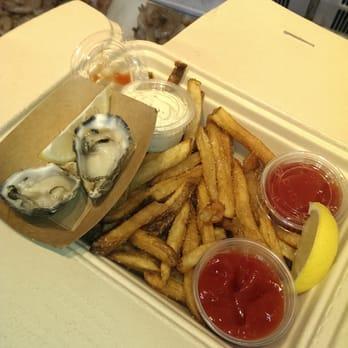 Photo of Hapuku Fish Shop - Oakland, CA, United States. Shucked oysrers and garlic fries