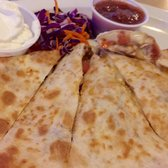 'Photo of The Longboard Restaurant & Pub - Huntington Beach, CA, United States. Chicken Quesadilla - HH Menu' from the web at 'https://s3-media1.fl.yelpcdn.com/bphoto/5iu4_u9LtEwd_5cwXRpB7Q/168s.jpg'