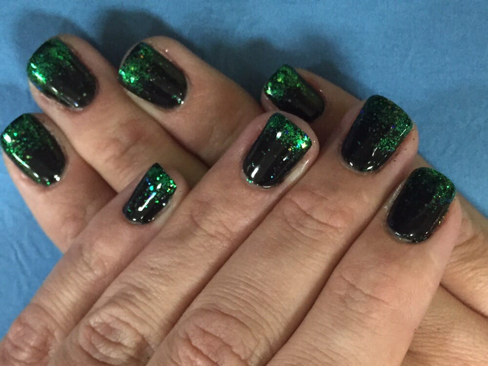 Black with emerald green fading glitter gel at the tips - Yelp