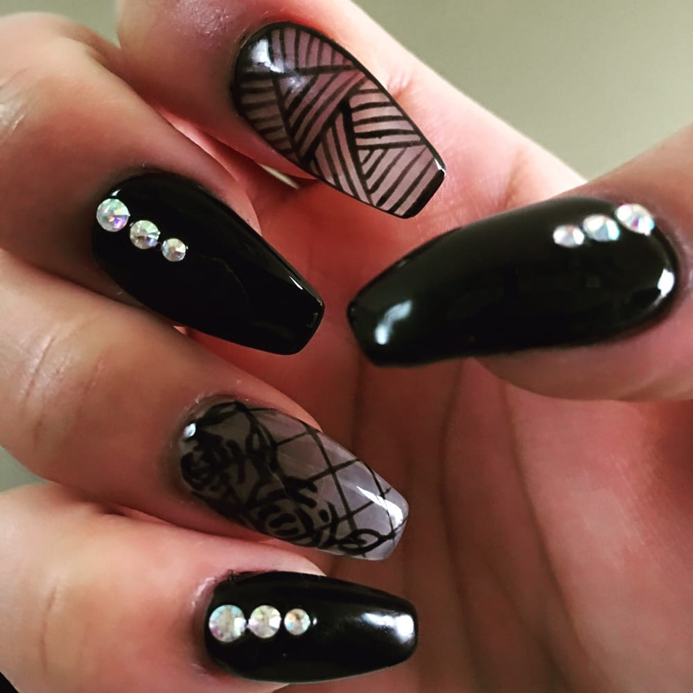 Beautifully done ballerina shaped nails in black gel polished with ...