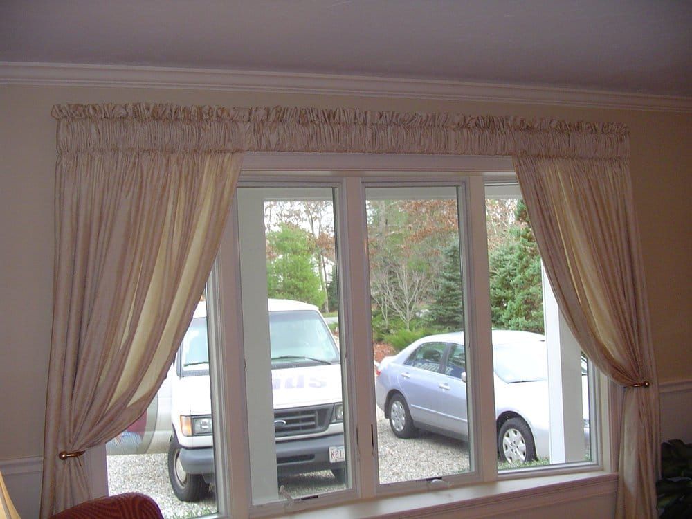 Simple And Sheer Drapery Panels And Valance Frame The