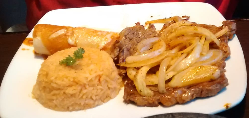 ... skirt steak with a chicken enchilada, rice, charro beans, and pico de