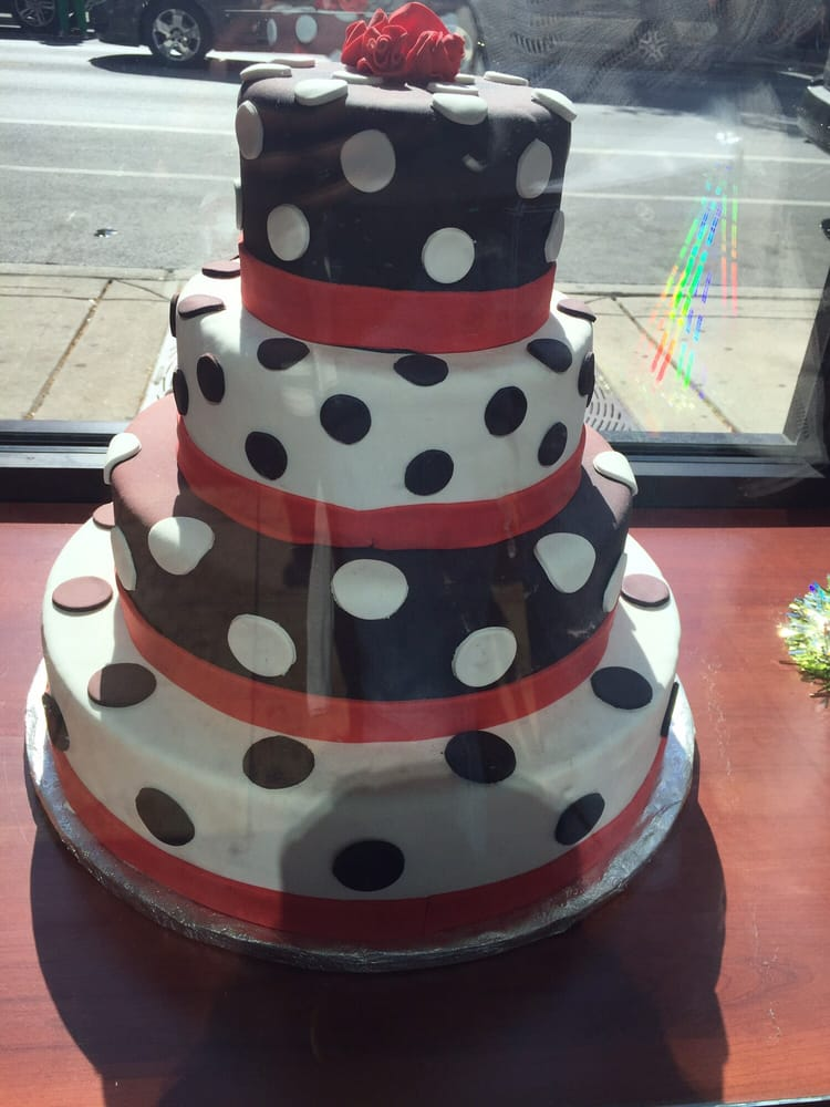 One Of The Cakes On Their Display With Crooked Ribbon And Lumpy