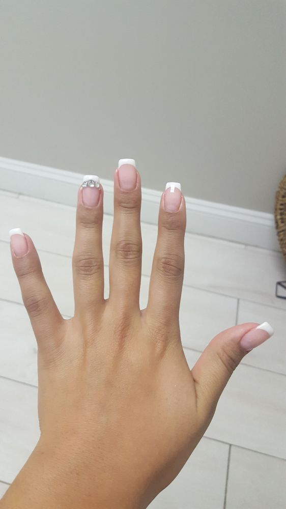 gel french manicure with tips amd some studs on the ring finger - Yelp