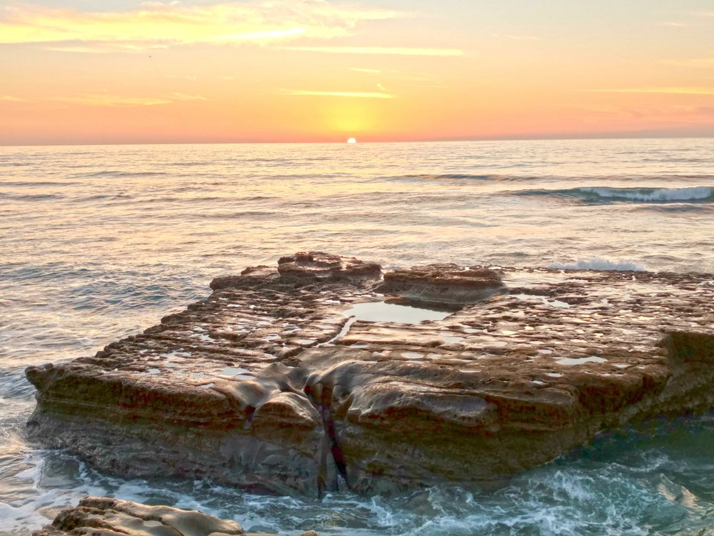 Photo of Torrey Pines State Reserve's iconic Bathtub rock at sunset
