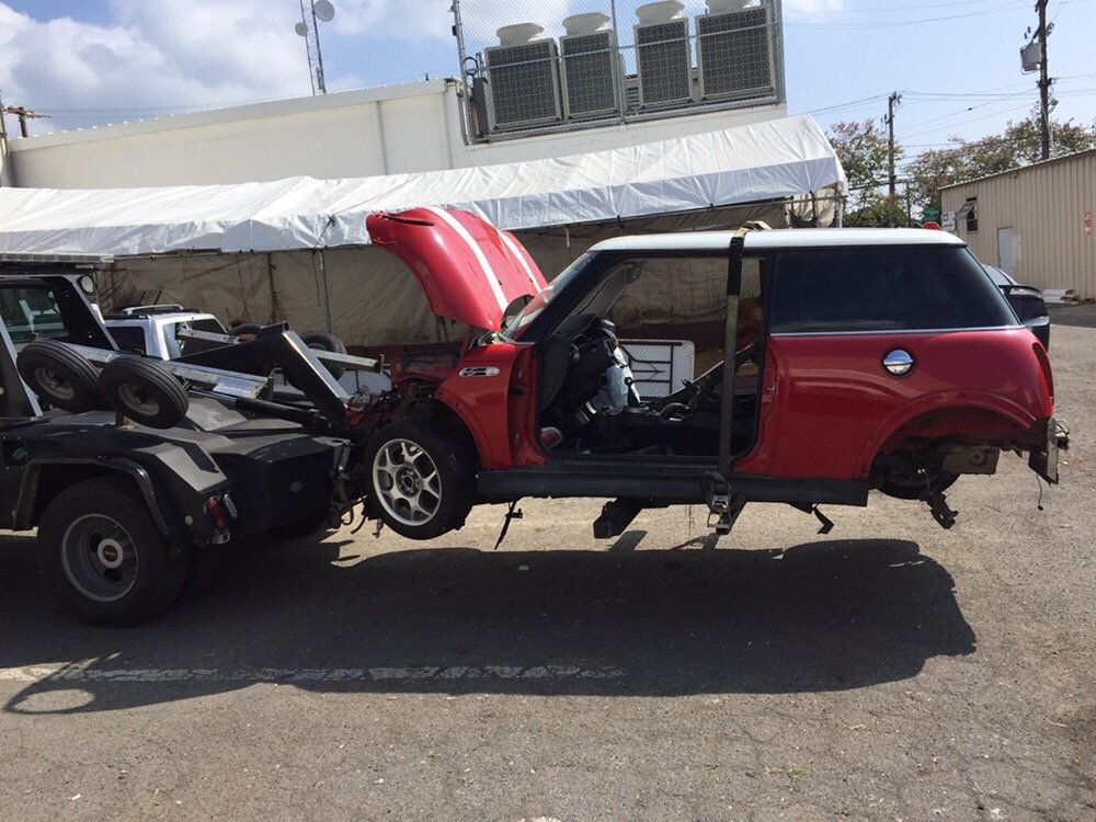 Took this Mini Cooper to the junkyard! Missing a few wheels, so we ...