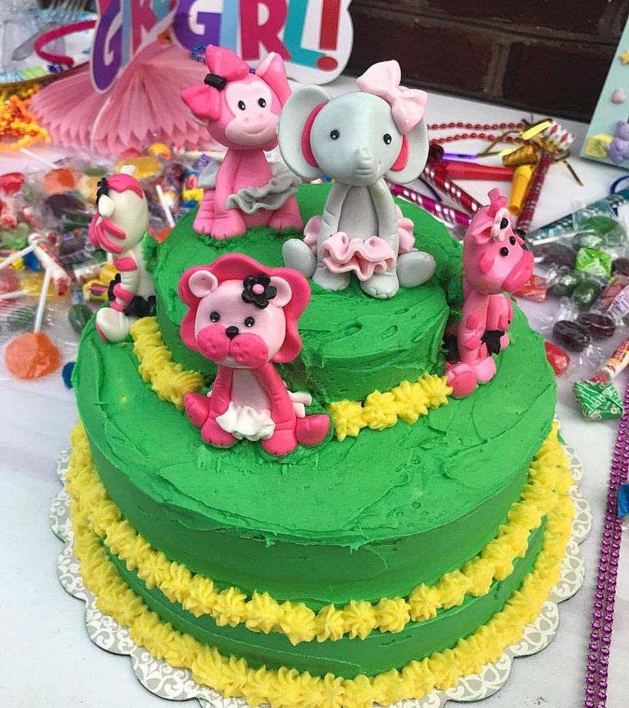 A Safari Themed 1st Birthday Cake Vanilla Cake Layers With Vanilla