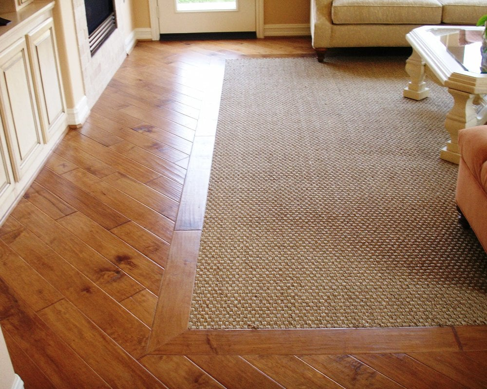 in carpet first over laminate choice hardwood for store austin and king years flooring floor s