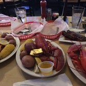 'Photo of The Longboard Restaurant & Pub - Huntington Beach, CA, United States. Meal for 3, waiting on 1 steak and 1 lobster. Lobster was excellent!' from the web at 'https://s3-media1.fl.yelpcdn.com/bphoto/9ZFvca7eJS-SG_8TcPyzAA/168s.jpg'