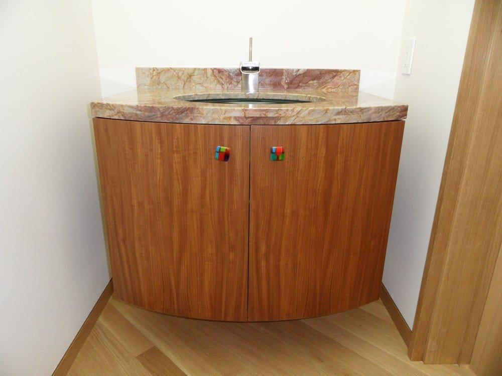 floating curved door powder bath cabinet quartered afromosia