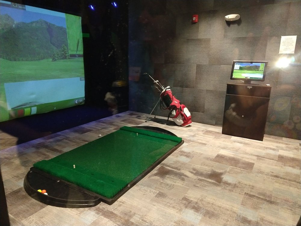 Theres A Game Room With A Golf Simulator As Well As Arcade Machines
