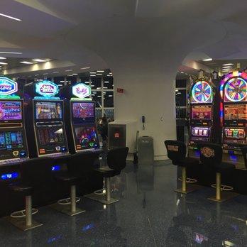 'Photo of McCarran International Airport - Las Vegas, NV, United States. Southwest B wing slots!' from the web at 'https://s3-media1.fl.yelpcdn.com/bphoto/ARCMAACoLJW_7H5Y3MFP5w/348s.jpg'