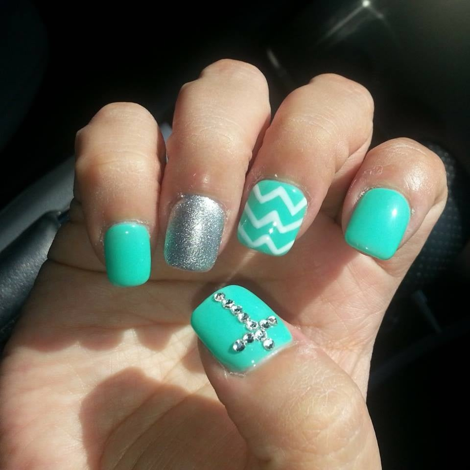 Gel nails with chevron design and rhinestone cross. I have received ...