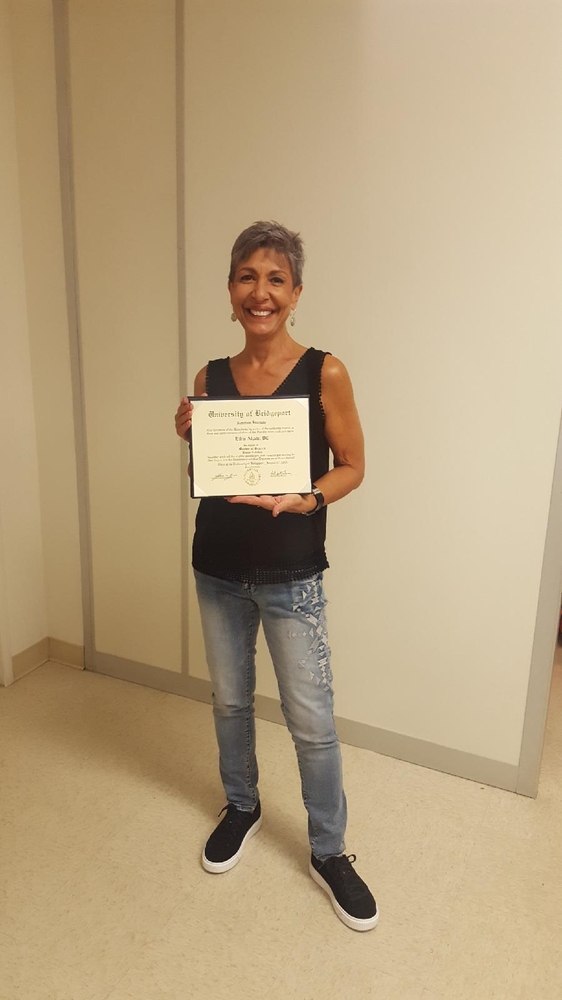Dr. Alzate, D.C., received her Master's