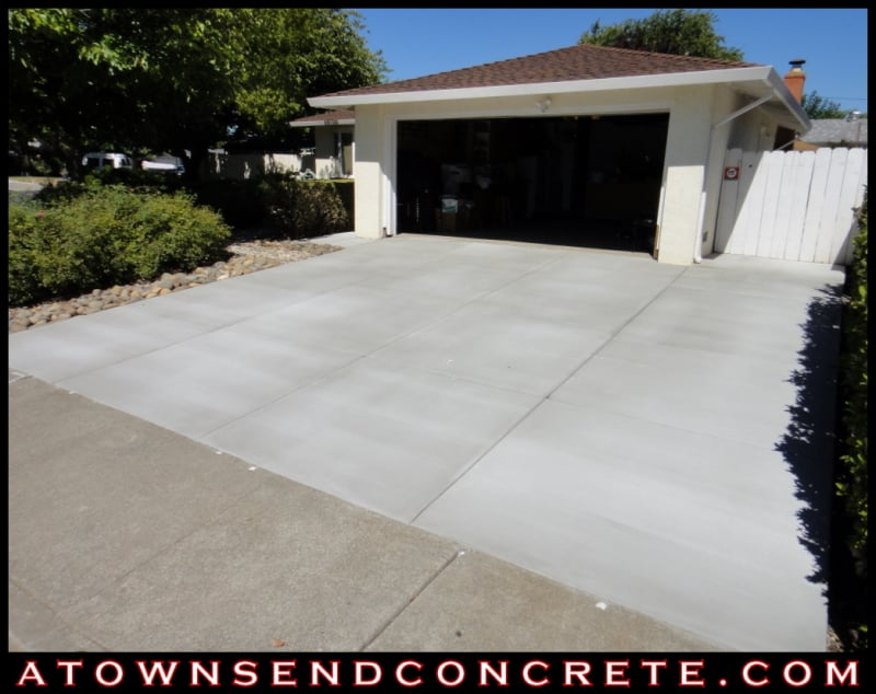All new broom finish concrete driveway with walkway to front door ...