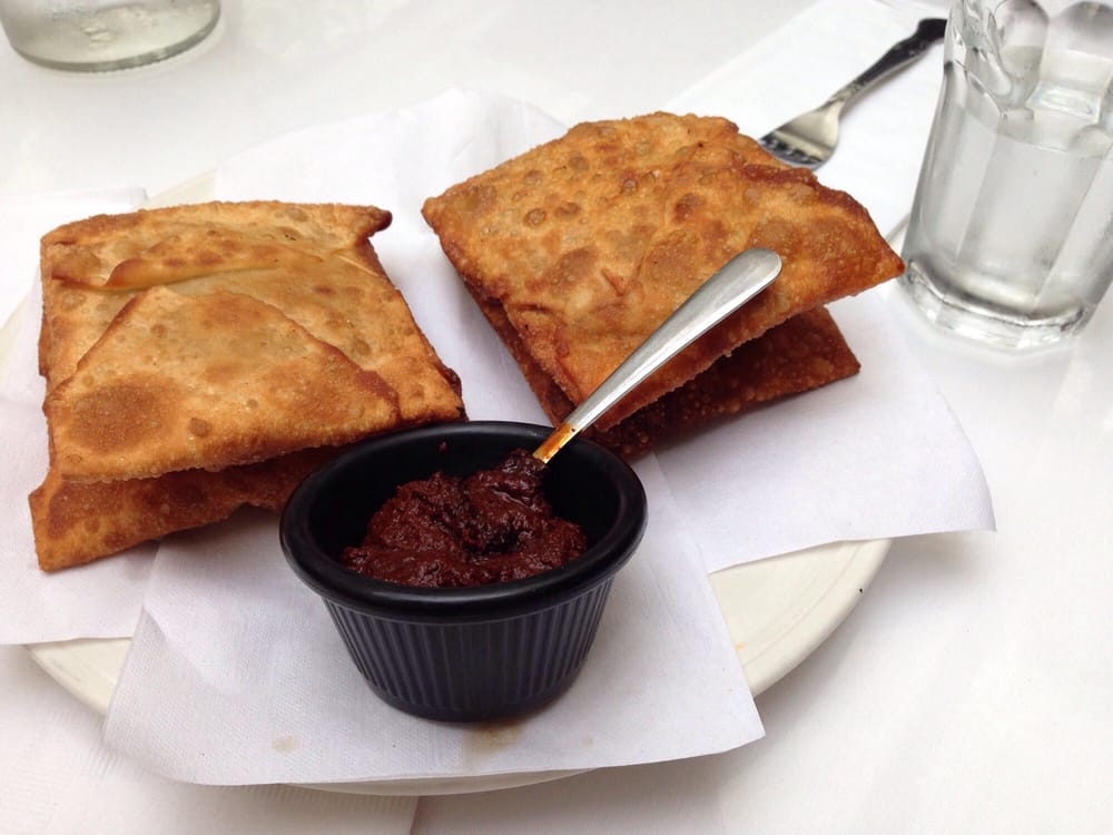 Photo of New Eritrea Restaurant & Bar - San Francisco, CA, United States. Meat and vegetable sambusas with unbelievably delicious chile paste