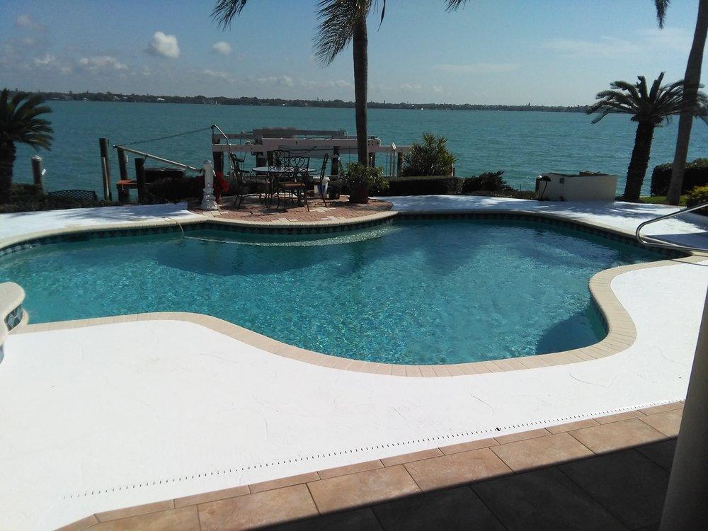 Pool deck on bird key sarasota florida pressure cleaned for Florida pool and deck