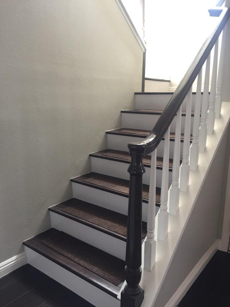 White Risers On Stairs To The Upstairs Looks Like A Brand New Home