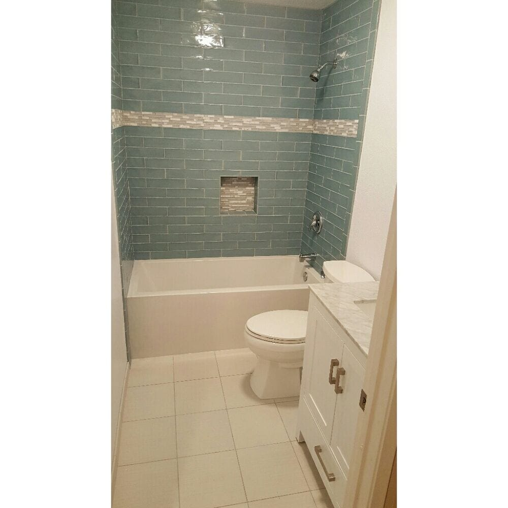 Bathroom remodeled. Tub Plumbing Tile Shampoo box (nitch ...