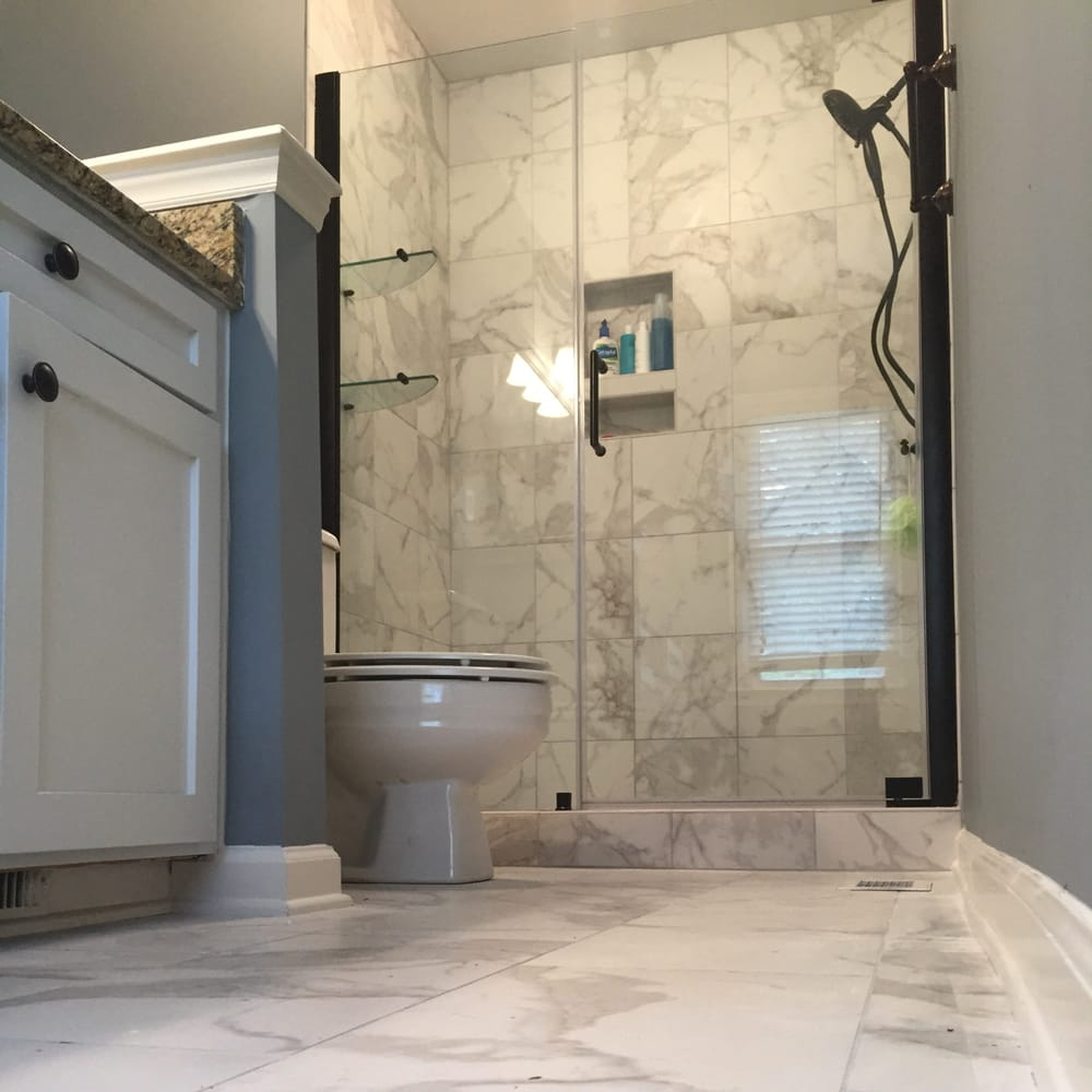 Bathroom Renovations Charleston Sc bathroom remodel with faux marble tile. it's porcelain made to