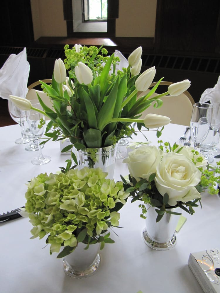 Groupings of centerpieces in faux mint julep using white